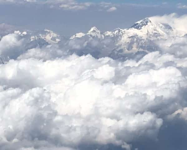 photo from the plane from Paro to Delhi The triangular peak in the background is EverestIMG_1649