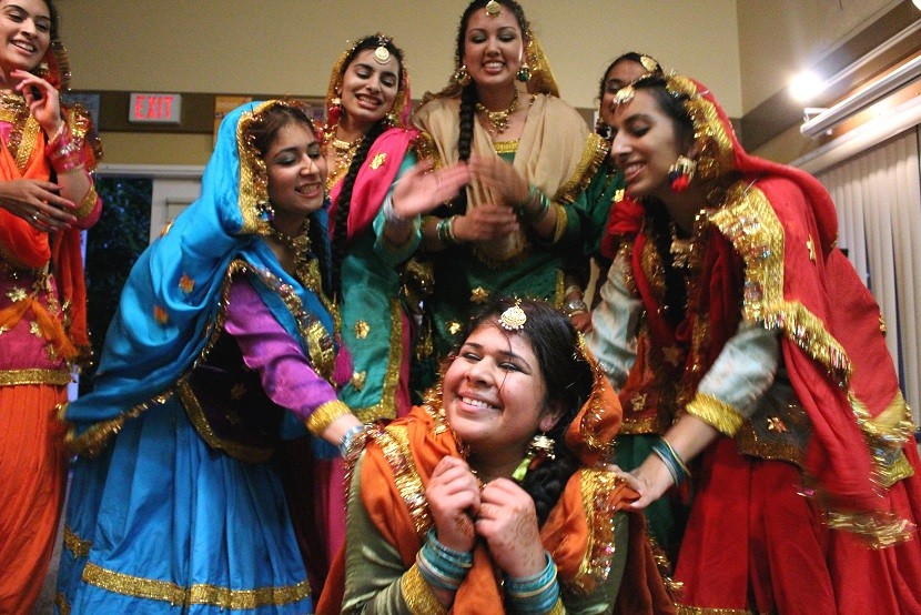 Women dancing during Teej. Image courtesy of the University of the Fraser Valley via Creative Commons